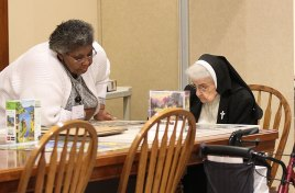 Providence Associate Sandra Wickware joins Sister Helen Therese Conway in working on the puzzles during some down time in the retreat.