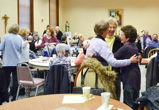 At right, Sister Theresa Clare Carr and Providence Associates Jeanie Fentz and Yvonne Conniff join in an excited hug as the retreat gets started.