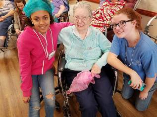 Providence teen volunteers Alyssa Rivera (left) and Imogen Anderson with Sister Laurine Haley.