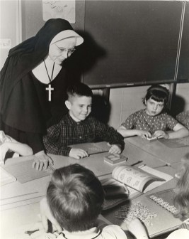 Sister Brendan Harvey (RIP) works with students on a project.