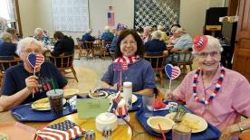 Celebrating July 4th during the annual meeting, from left, Sisters Mary Ann Phelan, Norene Wu and Joann Quinkert.