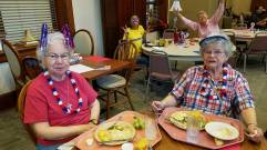 In their red, white and blue for the 4th are Sisters Mary Catherine Guiler and Marie Denis Lucey.