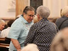 Sister Andre Panepinto visits with another sister before Mass.