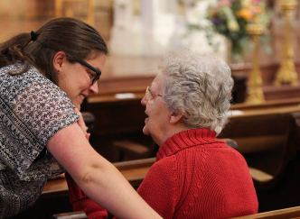 Sister Emily greets Sister Barabara Doherty before the Mass
