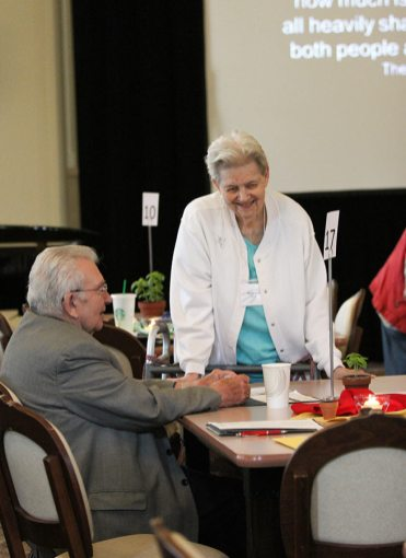 Sister Mary Ann Fox chats with Providence Associate Father Dan Hopcus during a break in Monday's meeting.