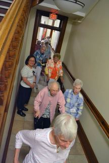Sisters travel down a hallway in Providence Hall to their next demonstration Sunday evening.