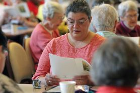 Providence Associate Kim Knoblock during a prayer moment at Monday's annual meeting with the sisters.