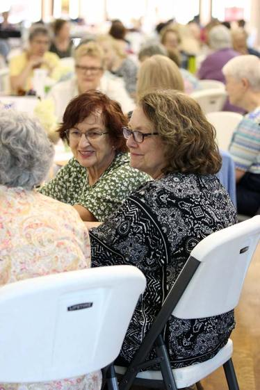 Providence Associates Margaret Stewart and Teresa Clark listening during table conversation on Saturday.