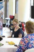 Providence Associate Ursula Penrose listens at her table.