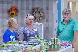 Marylu (center) and Greg Thralls have supported the pantry for many years.