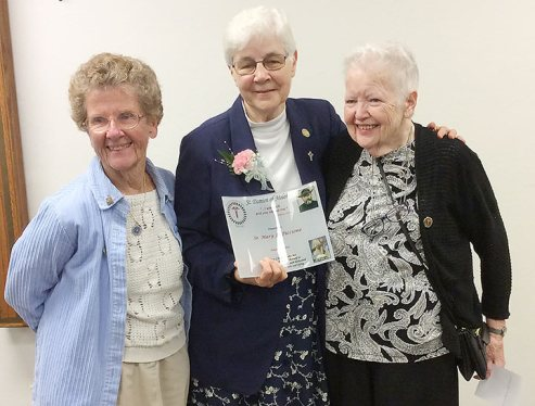 Sister Mary Jo Piccione (center) is joined in celebration after receiving the Saint Damien Molokai award with (from left) Sister Josephine Bryan and Sister Grace Marie Meehan.