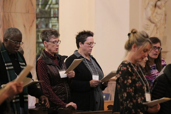 Sister Mary Tomlinson and her candidate companion Kelly Schubert sing during the blessing ceremony