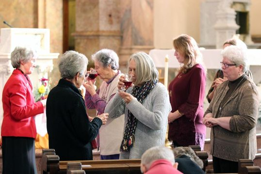 Providence Associate Terry Urban receives communion