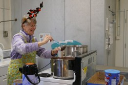 Sister Mary Montgomery dishes out hot chocolate