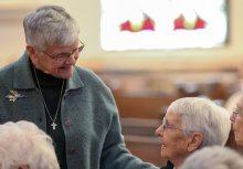 Sister Denise Wilkinson greets Sister Margaret Norris before Mass