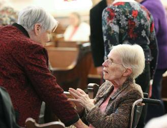 Sister Rosemary Nudd visits with Sister Ellen Cunningham before Mass