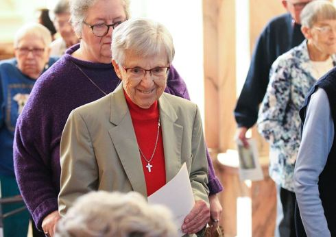 Sister Rosemery Eyler greets sisters after Mass