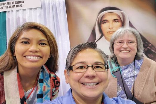 Sister Jessica (left) and Sister Joni (center) with a visitor at the Sisters of Providence booth during the Los Angeles Religious Education Congress.