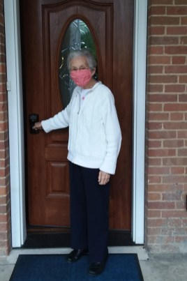 Sister Regina Marie McIntyre leaving Corbe House to go to Providence Hall.
