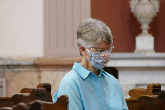Sister Mary Montgomery joins the Congregation by praying the Lord's Prayer towards the end of the Sunday prayer service.