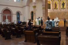 All sisters gathered raise their hands in blessing over the newly professed sisters.