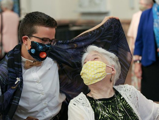 Sister Corbin poses as batman with her cape with Sister Rosemary Nudd after the ceremony