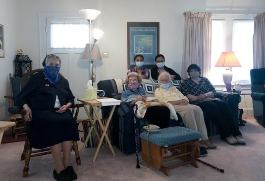 Sisters small group gathered at the formation house at the Woods. Front row from left: Sisters Jane Michael Dwyer, Lucy Nolan, Mary Frances Keusal, Judith Cervizzi. Back row Sisters Jessica Vitente and Teresa Kang