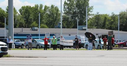 Sister demonstrators stand on the side of US 41 in Terre Haute joining anti-death penalty protestors on Friday.
