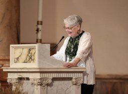 Sister Rosemary Nudd proclaims a reading at the Mass