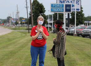 Sister Mary Montgomery speaks with a reporter during Wednesday's protest