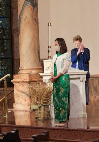 Sister Dawn and all those gathered applaud Sister Teresa after she professes first vows