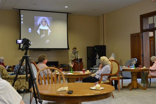General Superior Sister Dawn Tomaszewsk speaks to all the sisters gathered in person and via livestream