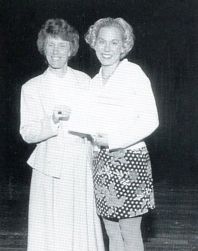 Sister Jeanne Hagelskamp presents Christina Relich with the NASSP Principal's Leadership Award while ministering as principal at Mother Theodore Guerin High School in 1997.