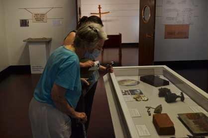 Sister Barbara Bluntzer looking at exhibit pieces.