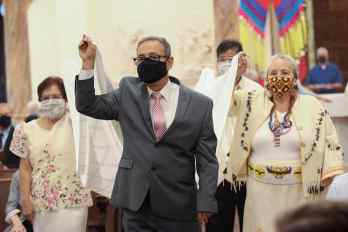 Friends and family members carry in the altar cloth during Mass, including Providence Associate Shawn Shamsaie, front.