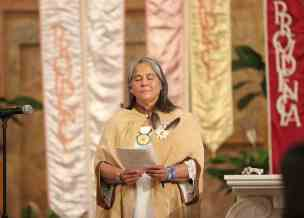 Sister Joni prays silently during the vows ceremony.