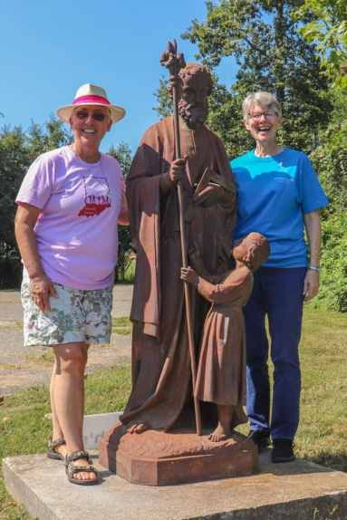 Sisters standing with the new St. Joseph's statue.