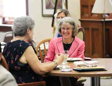 General Officer Sister Jeanne Hagelskamp visits with an associte during lunch.