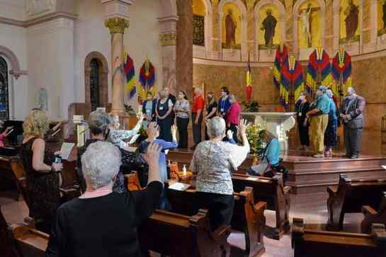 Those gathered bless the new Providence Associates.