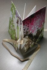 concertina no. 1 - accordian fold book with ribbon embellishment in gold