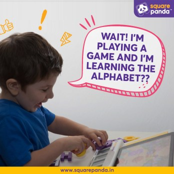 Little happy boy playing with the Square Panda educational games