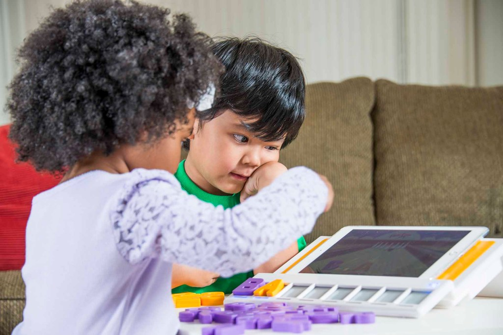 Two young learners playing with the Square Panda phonics platform.