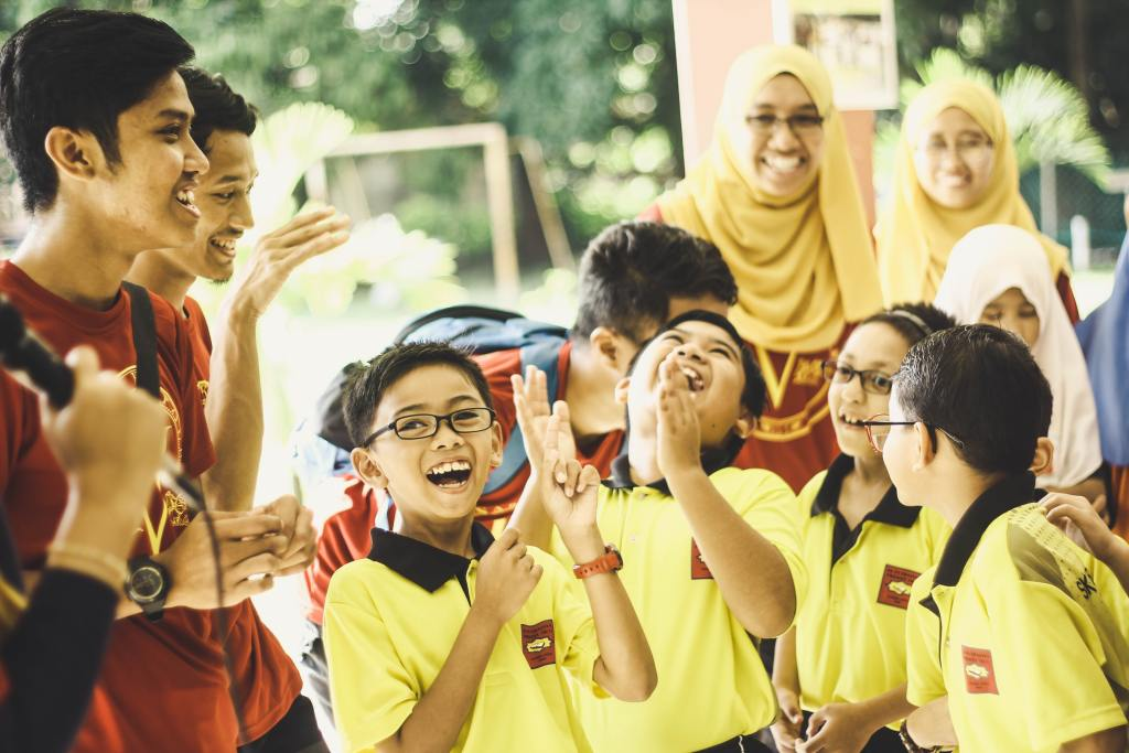Young learners laughing and playing