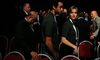 Head bowed, WSF president N Ramachandran walks behind squash legends Ramy Ashour and Sarah Fitzgerald as the IOC announces that wrestling has been returned to the 2020 Olympic Games