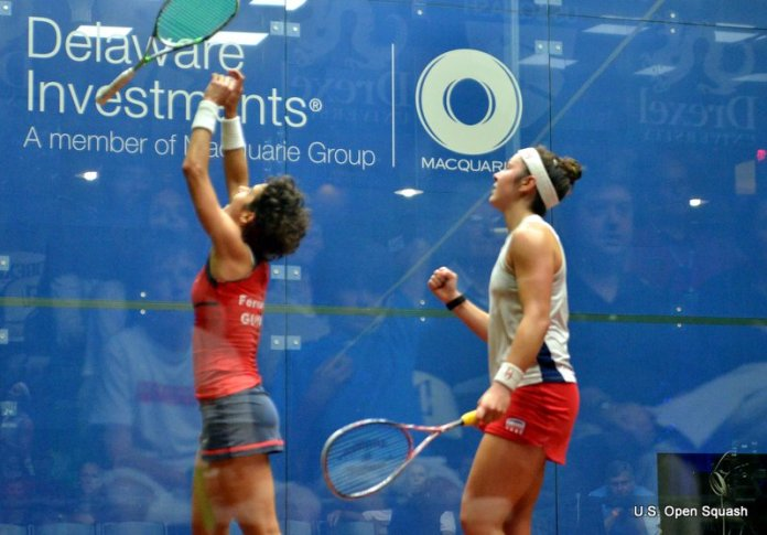 Sobhy (right) celebrates as Fernandes hurls her racket into the air
