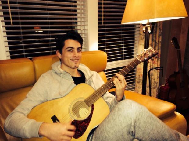 JOE STRUMMER: Surrey star Joe Lee with his guitar