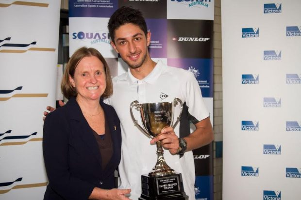 Sam gets his trophy from Aussie legend Vicki Cardwell