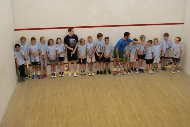 Todd Harrity and Robbie Downer join the juniors on court