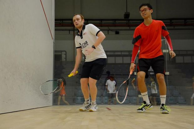 Andrew Cross (left) training with promising junior Ng Eain Yow