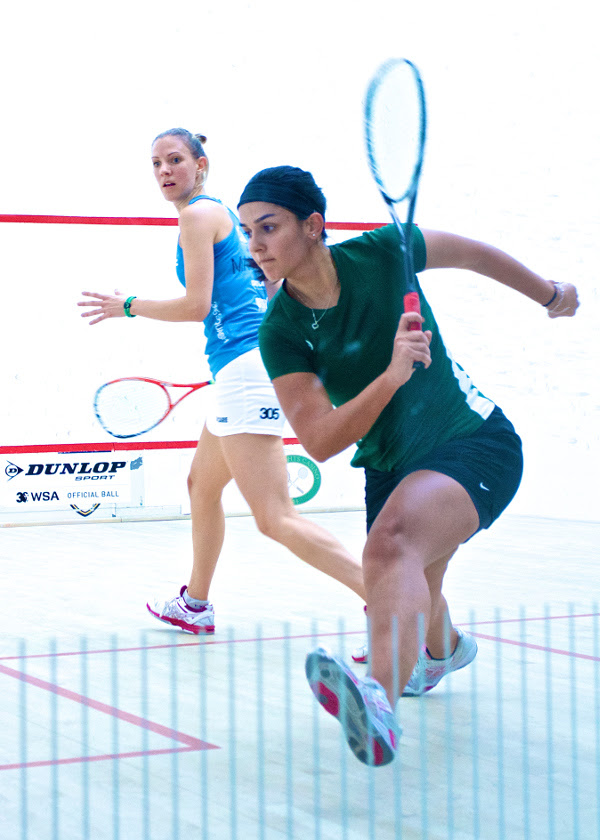 Omneya Abdel Kawy chases the ball into the back left corner as Laura Massaro watches from the T